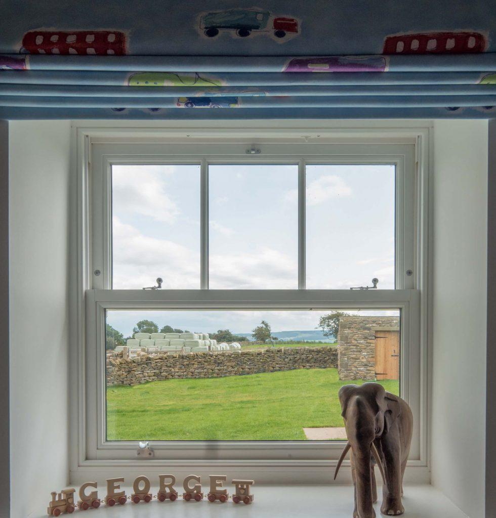 White sliding sash window