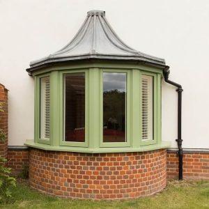 Green timber bay window