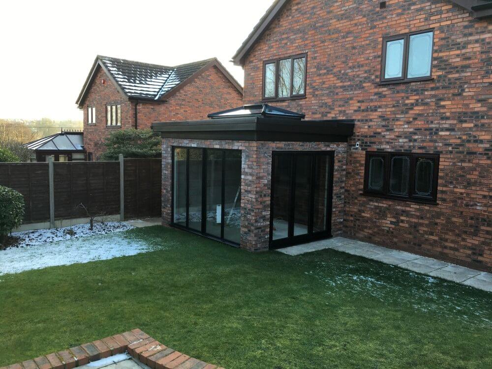 Black aluminium bifolds, windows and roof lantern
