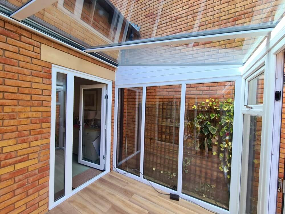 White lean to conservatory