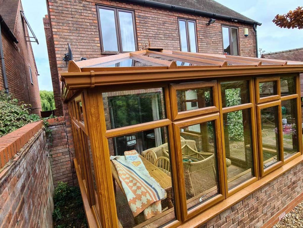 golden oak conservatory with glass roof