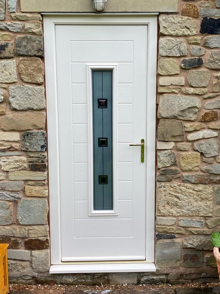 A white entrance door